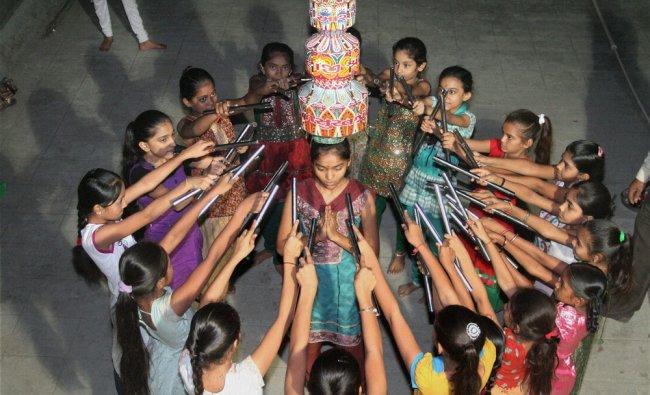 Girls practicing \'Garba Ras\' ahead of Navratri festival in Surat on Saturday.