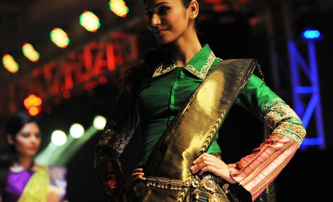 A model walks the ramp during the Asopalav Bridal Couture Fashion Show in Ahmedabad late on...