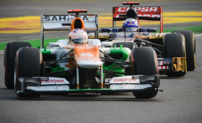 Force India-Mercedes driver Paul di Resta of Britain (front) is tailed by Toro Rosso-Ferrari...