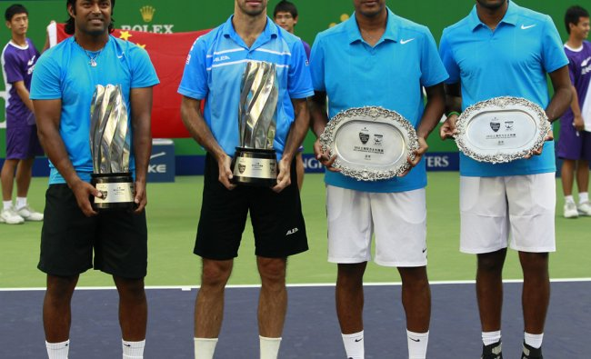 Leander Paes, of India, left, and Radek Stepanek, of the Czech Republic, 2nd left, hold the...