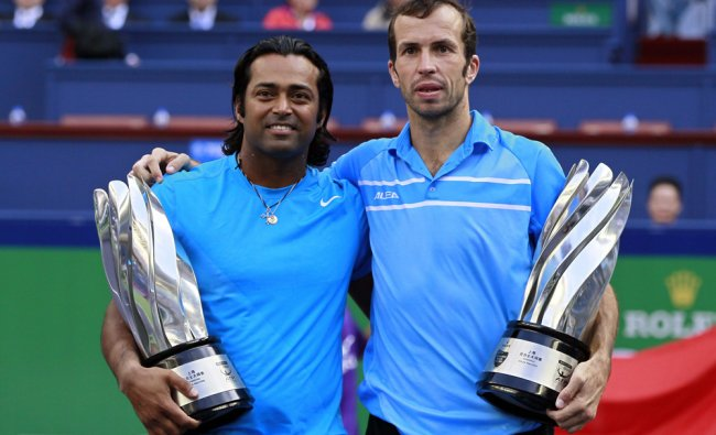 India\'s Leander Paes (L) and Radek Stepanek of the Czech Republic pose with trophies after...