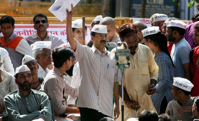 India Against Corruption activist Arvind Kejriwal addresses his supporters near the Parliament...