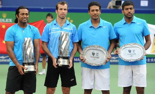 Leander Paes of India (L) and Radek Stepanek of the Czech Republic (2nd L) hold their trophies...