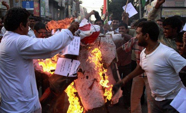 Supporters of activist Arvind Kejriwal burn effigies of Salman Khurshid and Robert Vadra...