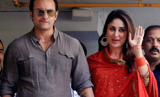 Bollywood stars Saif Ali Khan and Kareena Kapoor greet fans from their balcony after getting...