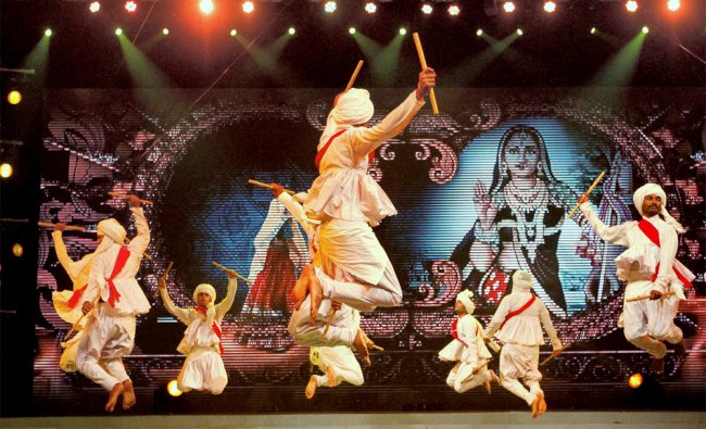 Youngsters perform Garba and Rass during Navratri celebration in Ahmedabad on Tuesday...