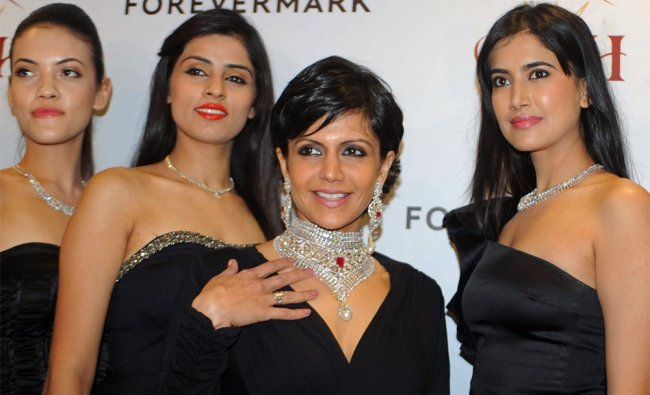 Indian actress Mandira Bedi (2nd R) poses with models during a promotional event for a jewellery...