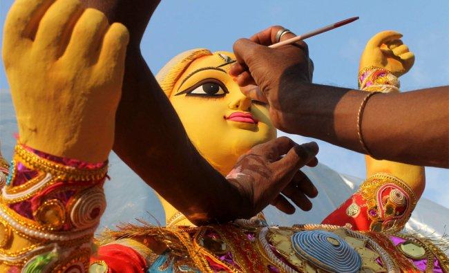 An artist works on an idol of Hindu goddess Durga in Agartala, India, Tuesday, Oct. 16, 2012...