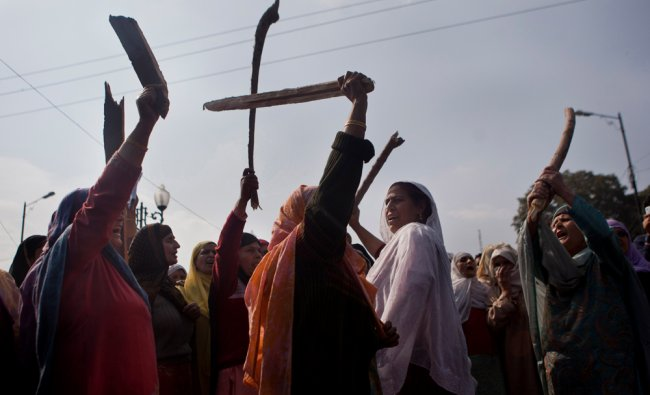 Kashmiri Muslim women shout anti-government slogans during a protest