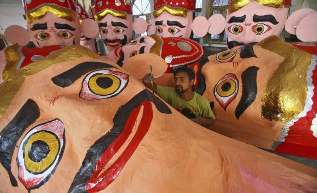 An artisan gives finishing touches to an effigy of demon king Ravana in preparations for the...