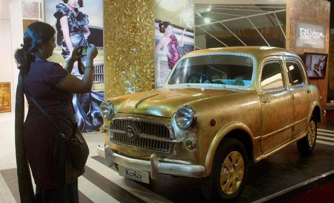 An Italian Rose Gold Vintage car at an exhibition at Bandra in Mumbai on Thursday.