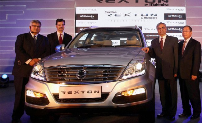 Mahindra & Mahindra Chief Executive (Automotive Division) Pravin Shah (2nd R), Vice President...
