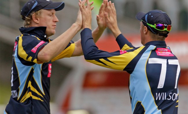 Yorkshire\'s Steven Patterson reacts with a team mate as Mumbai Indians\' Dwayne Smith gets out ...