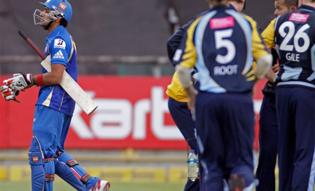 Mumbai Indians Rohit Sharma walks of the field after he lost his wicket against Yorkshire ...