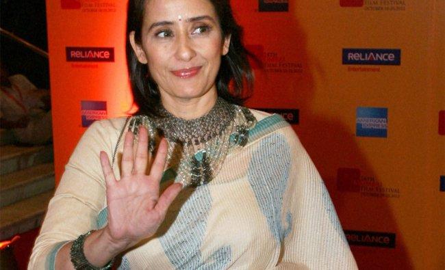 Manisha Koirala arrives at the 14th Mumbai International Film Festival in Mumbai ...