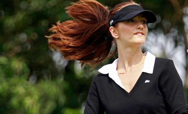 American actress Minka Kelly walks on the fairway during the pro-am games