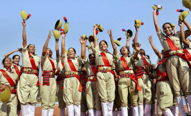 Women police constables celebrate after their passing out parade