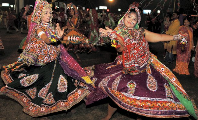 oungsters take part in a Garba programme during Navratri festival
