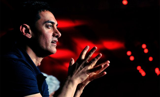 Indian Bollywood actor Aamir Khan talks during the soundtrack launch for the forthcoming Hindi film