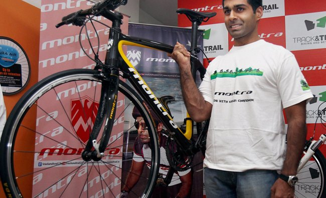 Formula One driver Karan Chandhok poses with a new range of \'Montra\' bicycle