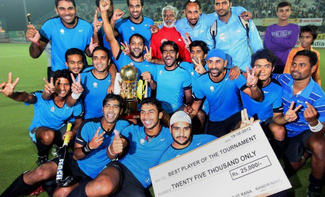 Members of the Indian Oil hockey team jubilate as they pose for a group photo