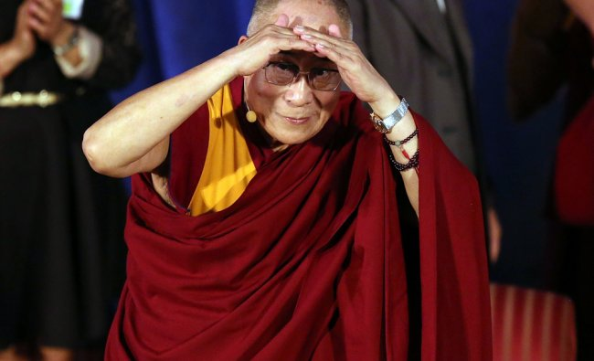 Dalai Lama stands on stage at Hunter College where he received an honorary degree