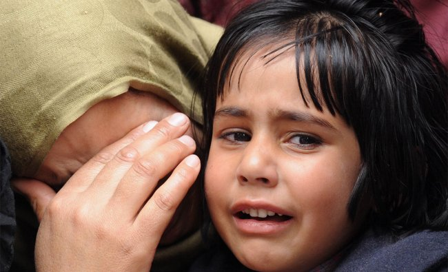 Kashmiri villagers mourn deceased hotel bellboy Farooq Ahmad during his funeral procession