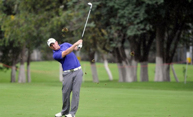 Scottish golfer Richie Ramsay plays a shot during the third round of the Hero Indian Open 2012