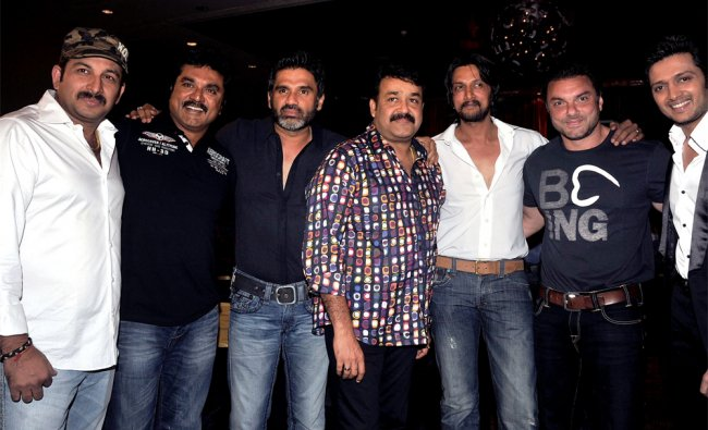 Indian movie actors from different languages pose during the announcement of new CCL teams in Mumbai