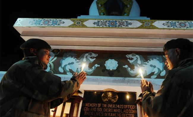 Indian Army personnel light candles at the Tawang War Memorial in Arunachal Pradesh...