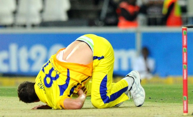 Chennal Super Kings bowler Albie Morkel falls during the match...