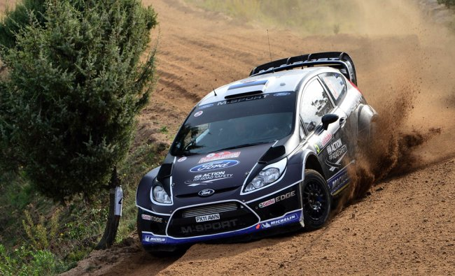 Ott Tanak and co-driver Kuldar Sikk steer their Ford Fiesta during FIA World Rally Championship