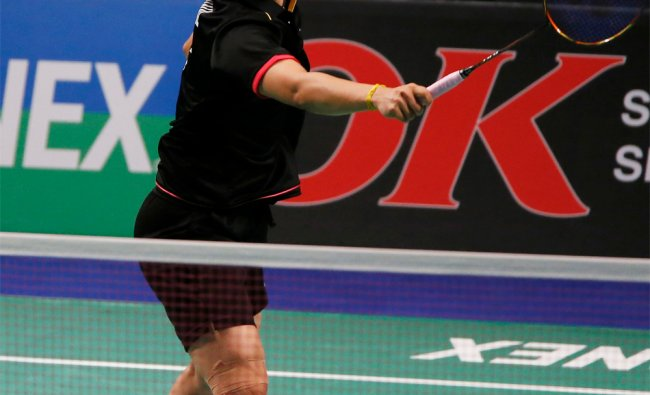 Saina Nehwal of India competes during the Denmark Open woman\'s single final badminton match against