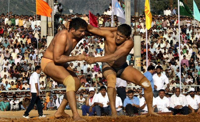 Indian and a Pakistani wrestler during a friendly bout at Swami Vivekananda Sports Stadium during...