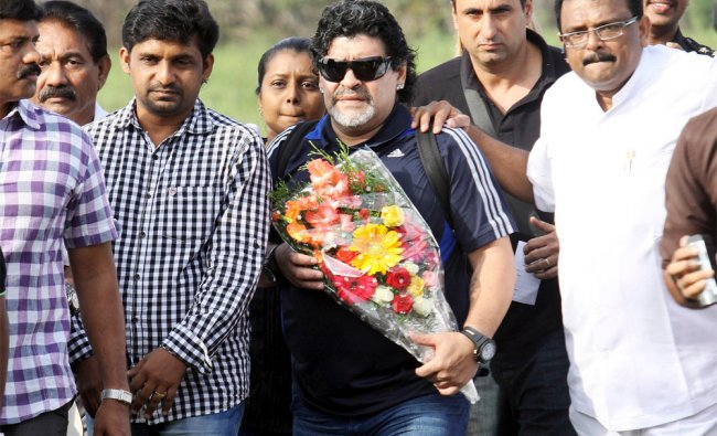 Argentina soccer legend Diego Maradona, center, arrives in Kannur, Kerala, India, Tuesday...