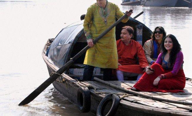 Brazilian footballer Dunga riding a boat across Ganga River