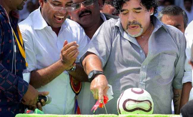 Footballer Diego Armando Maradona cuts a cake to celebrate his 52nd birthday in Kerala...