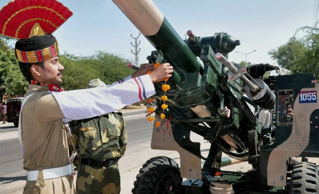 BSF soldiers performing worship of a tank on the occasion of Vijayadashmi in Bikaner on Wednesday...