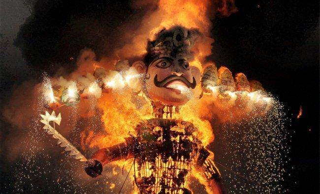 The effigy of demon king Ravana burns during Dussehra celebration in Faridabad on Wednesday...