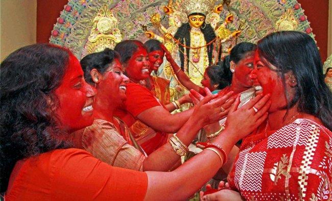 Married women participate in Sindur Khela at a Durga puja pandal on Bijoya Dashami in Birbhum...