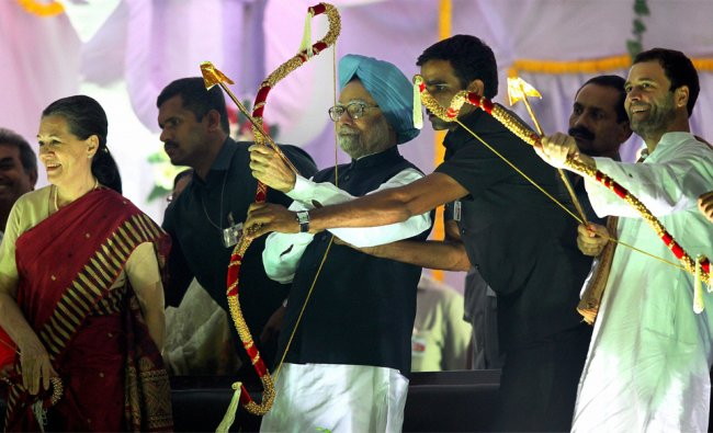 Prime Minister Manmohan Singh and Congress General Secretary Rahul Gandhi aim with bow and arrow...