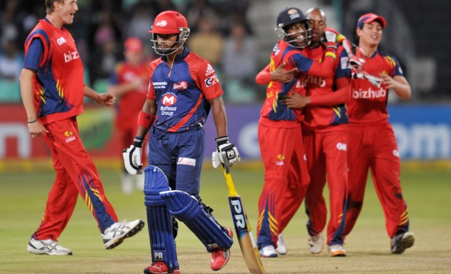 Pawan Negi of Delhi Daredevils, foreground, leaves the field during their Twenty20 semifinal...