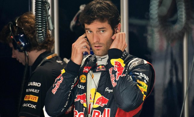 Mark Webber of Australia gestures as he gets ready during the first practice session