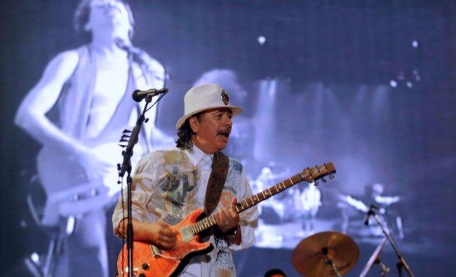 Carlos Santana performs during the \'Rock N India\' debut concert in Bangalore