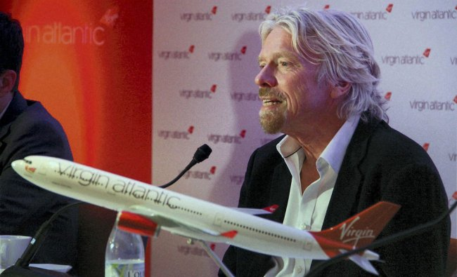Owner of Virgin Group Richard Branson interacts with media at the launch of Virgin Atlantics...