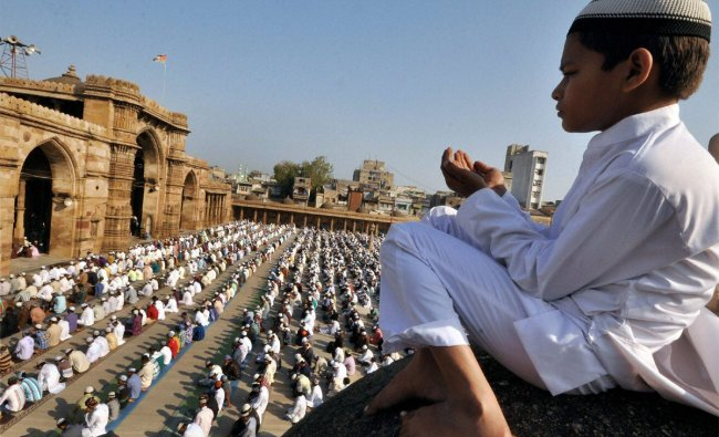Muslims offer Eid-ul-Zuha prayers at the Shahi Jama Masjid Mosque in Ahmedabad on Saturday