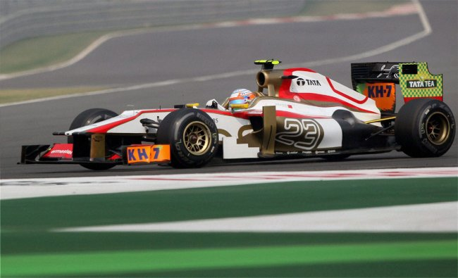 HRT driver Narain Karthikeyan steers his car during the third practice session