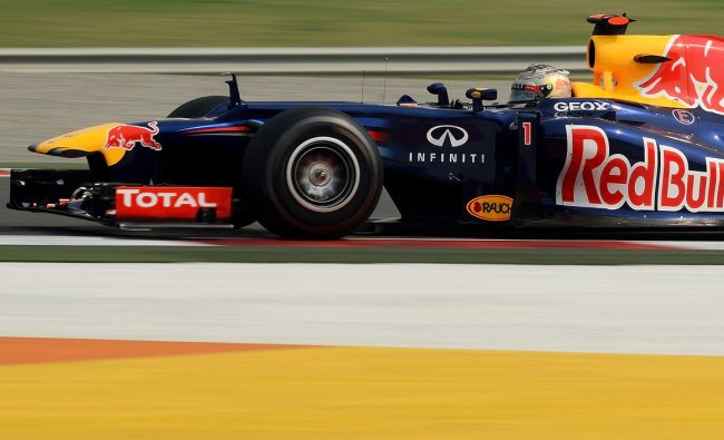 Red Bull-Renault driver Sebastian Vettel of Germany powers his car during the third practice session