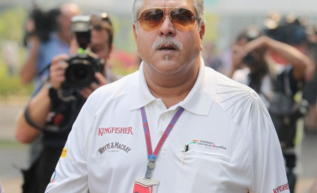 Vijay Mallya arrives in the paddock during final practice of the Indian Grand Prix