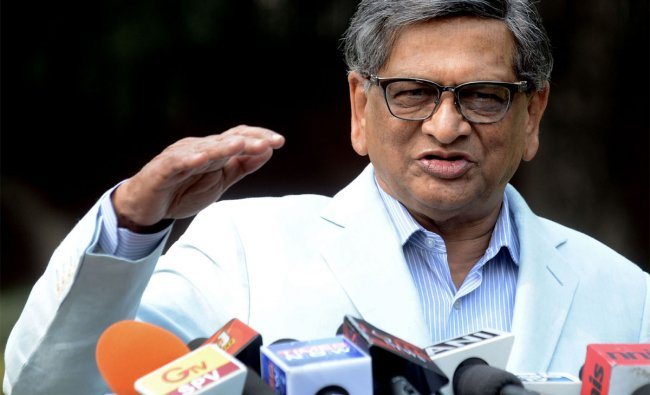S.M. Krishna speaks with media representatives at his residence after his resignation
